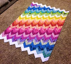 .I like the gradient color effect of this quilt.  Good example of how to put colors together.