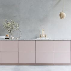 Beautiful pink kitchen with marble worktop