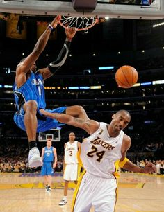 Orlando Magic center Dwight Howard bangs one down on Kobe Bryant in L.A.