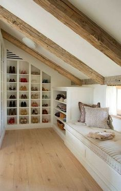Clever Attic Storage IdeasAttic Closet Ideas - Walk-in attic wardrobe includes a sloped ceiling lined with rustic timber light beams over angled built in footwear cubbies and sweatshirt racks beside a window seat. Attic Master Bedroom, Attic Bedroom Designs, Attic Bedrooms, Attic Design, Bedroom Loft, Modern Bedroom, Contemporary Bedroom, Design Bedroom, Bedroom Curtains