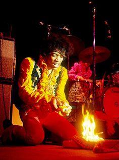 Jimi Hendrix burning his guitar at Monterey Pop Festival in California, 1967.