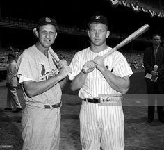 Outfielders Stan Musial of the St. Louis Cardinals and Mickey Mantle of the New York Yankees pose together prior to the 1960 All-Star Game on July 13, 1960 at Yankee Stadium in the Bronx, New York.