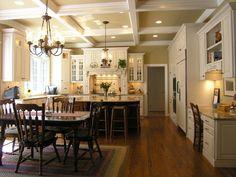 Light distressed cream cabinets, dark floor & island. Also, love ceiling!