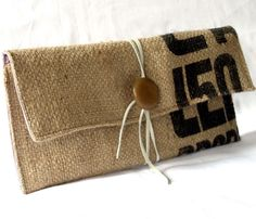 Made from a recycled burlap coffee sack, this eco-friendly clutch features a brown button and leather shoelace wrap closure. Lined in a lavender, pink, white, and turquoise stripe print. Burlap Coffee Bags, Coffee Bean Bags, Coffee Sacks, My Bags, Purses And Bags, Burlap Sacks, Hessian, Sacs Design, Sack Bag