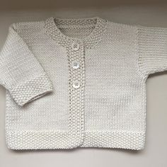 Baby Emily Knitting pattern by Stella AckroydA classic DK weight baby cardigan with elegant features and classic styling.Daisies new knitting mills till 2015 absolutely klein new favorite cardigan and a striped lama – ArtofitThis double knitting ya Baby Cardigan Knitting Pattern Free, Cardigan Pattern, Baby Knitting Patterns, Knitting Yarn, Hand Knitting, Wool Yarn, Baby Emily, Toddler Sweater, Knit Baby Sweaters