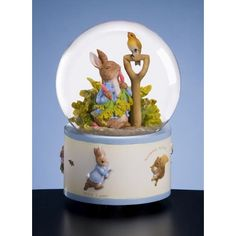 """Peter Rabbit is having a joyful day with his friend in this San Francisco Music Box Beatrix Potter and Peter Rabbit Eating Radishes Waterglobe.    Tune: """"Ode To Joy"""""""