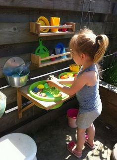 Cute Outdoor Play Kitchen = a shelf with cutouts = brilliant