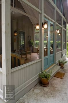 I would love a screen porch off the back of the house. farmhouse porch doors with accent walls accent door color