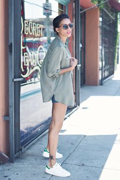 Long military, army green button down paired with denim shorts and Adidas Stan Smith sneakers.