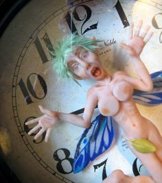 """""""Pressed for Time #1"""" 2012 Polymer clay sculpture in working clock by Gavy Swan"""