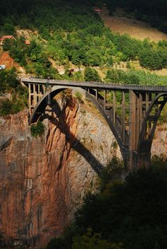 Tara River Canyon Bridge, Durmitor National Park, Montenegro. The 1,198 ft. long bridge has five arches; the largest span is 381 ft. The roadway stands 564 ft. above the Tara River. At the time of its completion, it was the biggest vehicular concrete arch bridge in Europe.