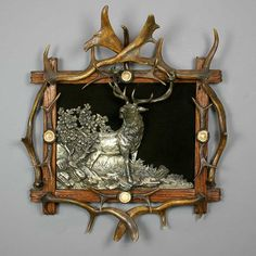 great antique black forest antler frame with tin stag in high relief, ca. 1900