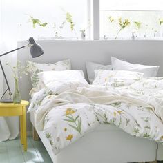 LOVE this image - makes me feel like spring is here | STRANDKRYPA bedding | Seasonal bedroom | Sunshine | STOCKHOLM bedside table | live from IKEA FAMILY