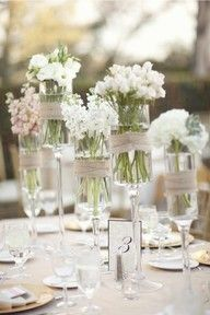 table seting flowers in glasses
