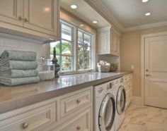I love this laundry room. Especially love counter that extends across the entire wall.