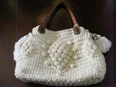 Crocheted purse.  Okay, JLo, here is my very own G Darel bag!!  Used straps from a recycled purse, lined with cream flowered cotton chintz, magnetic snap closure.  Very cool!