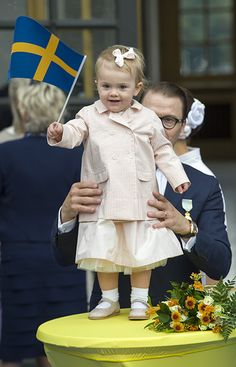 Princess Estelle of Sweden turns two: a gallery of the youngster's sweetest moments Dad Prince Daniel holds Estelle as she enthusiastically waves her flag for King Carl XVI Gustaf's 40th jubilee celebrations