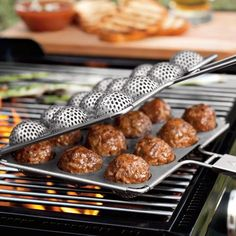 10 Great Grilling Gadgets ~ Meatball Grill Basket, Swashbuckling BBQ Sword, Wall Mounted Grill, Grand Grill Daddy Cleaning Brush and Cooking Gadgets, Cooking Tools, Pan Cooking, Cooking Rice, Camping Cooking, Cooking Videos, Outdoor Cooking, Popcake Maker, Bbq Meatballs
