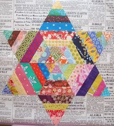 So I've got all my scrappy triangles cut from this post . I have been playing with them to try and figure out how to put them together. An...