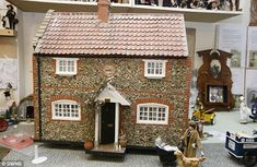 Bringing the past to life: Retired couple spend £100,000 recreating family tree through scale models