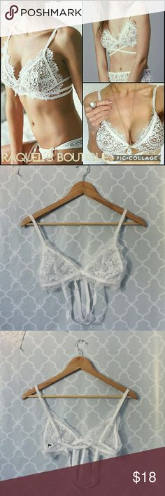 White Strappy Lace Bralette Details: Strappy white eyelash lace bralette with adjustable straps   Brand: Boutique brand   Size: Small / 30-32 A   Size: Medium / 32 B  Size: Large / 32-34 B/C   Condition: New, still in original packaging Intimates & Sleepwear Bras