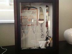 Wedding shadow box. Love it toast glass cake topper utensil used to cut cake all that's left is a picture of the bride and groom