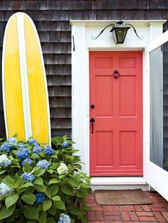 What a fun coral colored door!