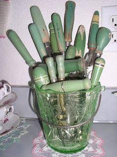 Vintage green handled kitchen utensils.