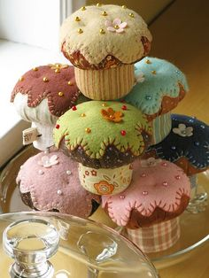 Felt Cupcake Pincushions. I would use them for little girls tea party instead!