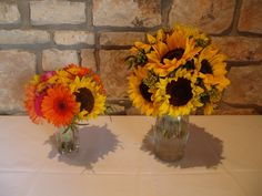 Bouquets of chrysanthemums, roses, sunflowers, and gerber daisies in tones of yellow, pink, and orange by Austin Wedding Florist Bella by Sara http://bellabysara.com/new/