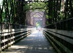Ride down the Norwottuck Rail Trail and enjoy the scenic views along the way. Level paths allow you to enjoy the trail no matter your abilities. The trail is also open to walking and rollerblading. Bike Ideas, Bike Trails, Hadley, Connecticut, East Coast, Massachusetts, New England, Paths
