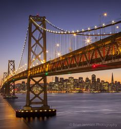 Oakland Bay Bridge with skyline of San Francisco beyond, California USA. © Brian Jannsen Photography