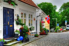The Charming Old Stavange - love the tardis colored doors!