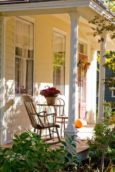 traditional porch by Rikki Snyder I like the use of a bistro table on the front porch. I could add my brown rocker with white/cream cushions.