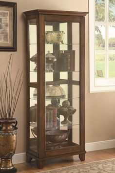 Coaster 950188 75 Inch Curio Cabinet with 5 Glass Shelves, Mirrored Back and Tapered Legs in Warm Brown Color Classy Cabinet, Furniture, Brown Living Room, Glass Shelves, Coaster Furniture, Glass Front Cabinets, Cabinet Design, Curio Cabinet, Dining Room Table Decor