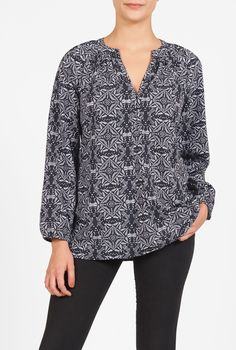 A banded, split neckline tops our casual-chic top detailed with a ruched…