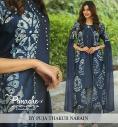 The Tussar #Extravaganza Indigo Tussar silk with #traditionally done batik on jacket and palazzo with cotton silk inner kurta. Long Georgette cape sleeves add to the style statement of this dress. Perfect semi formal outfit for you  #dress #semiformal #contemporarydress #silkdress #georgette #jacket #indigo #palazzo #cottonsilkdress #longkurta #panache #panachebypuja