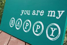 """Happy"" Art Project (I searched through free font download websites) I like ""american typewriter"" font."