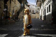 An ultra-orthodox Jewish boy wears a costume ahead of the Jewish holiday of Purim in Jerusalem's Mea Shearim neighborhood, on February 22, 2013.