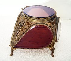 Lovely hinged and beveled glass lid is in excellent working condition. The velvet lining on the interior and the underside of the box is in good condition with little wear. Beveled Glass, Casket, French Style, Fashion Jewelry, Velvet, Legs, Gold, Jewelry Box, Stylish Jewelry