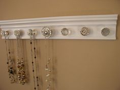 $42 + 25 Necklace organizer. This jewelry hanger has 7  knobs by Gotahangup