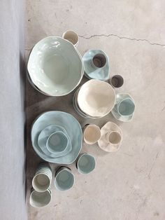 Blue and white shaded ceramic bowls and cups.
