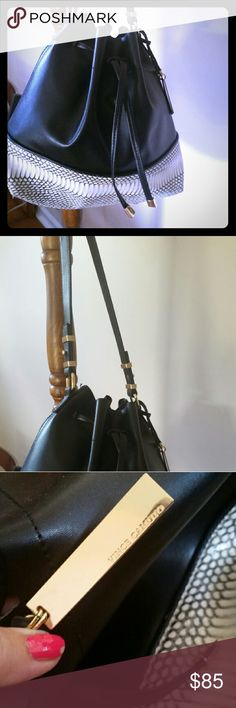 Vincent Camuto black leather w trim This bucket bag is gorgeous black with a cream and silver trim at the bottom.  Purchased in Norstroms 2 years ago and in perfect condition only used once. Vince Camuto Bags Crossbody Bags