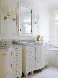 A Formal Touch    Fine details turn up the sophistication level of this light, bright bathroom to create a luxurious retreat. Custom-made vanities boast a unique rounded front and classy furniturelike styling with elegant marble countertops. Pretty framed mirrors and candlestick sconces dress up the paneled walls.