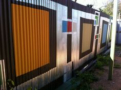 Great way to make a corrugated fence look amazing.