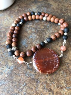 Dbl Wrap EO diffuser Bracelet Lovely cracked agate center piece with rosewood beads, lava stones, and Tibetan accent beads Create Your Own Website, Lava, Diffuser, Agate, Stones, Beaded Bracelets, Beads, Jewelry, O Beads