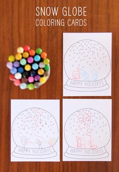 Let your kids decorate their own set of holiday cards this year with our festive printable snow globe coloring card!