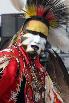 This is just like Mardi Gras...and it's spiritual!  I love this!  Native American dancer