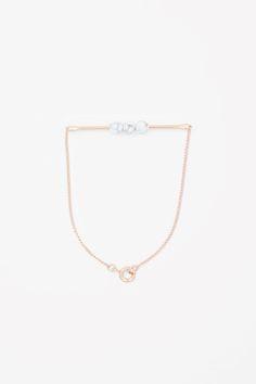 COS   Metal bar and bead bracelet