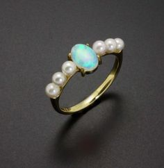 Opal and pearls 18K gold ring